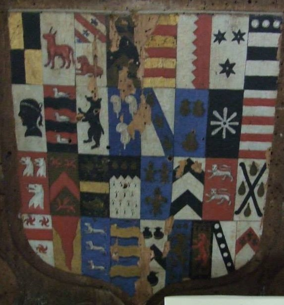 A Cornish coat of arms (left half of the shield) beside the coat of arms of a Devon family.